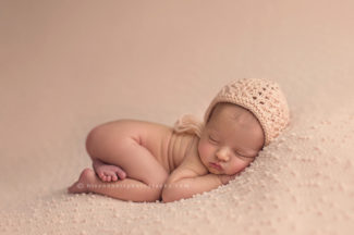 photograph of a newborn baby girl on blanket in des moines iowa